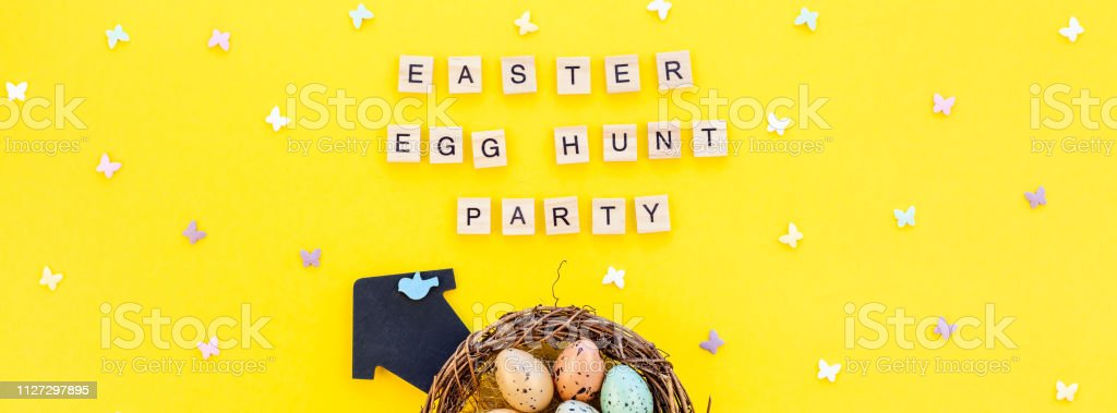 Creative Top view flat lay holiday composition Easter bunny ears eggs...