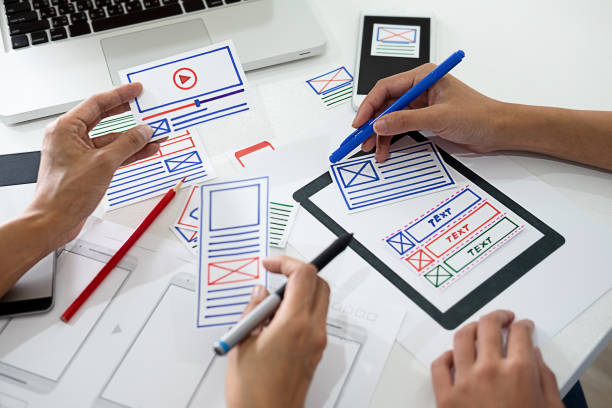 Creative Web Designer planning application and developing template layout, framework for mobile phone. User experience (UX) concept. stock photo