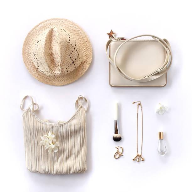 kreative frau hintergrund - goldenen stil kleidung und accessoires collage auf weißem hintergrund. flach legen, top aussicht - damen top gold stock-fotos und bilder