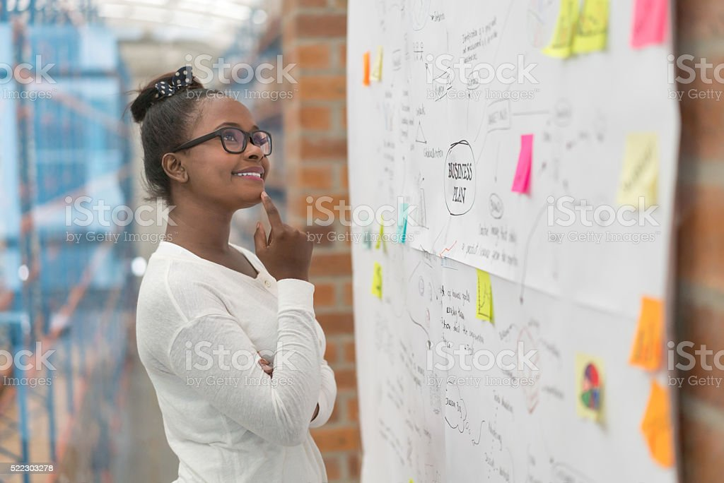 Creative woman drawing a business plan stock photo