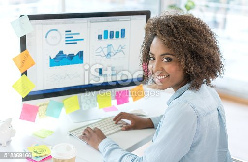 istock Creative woman working at the office 518869166