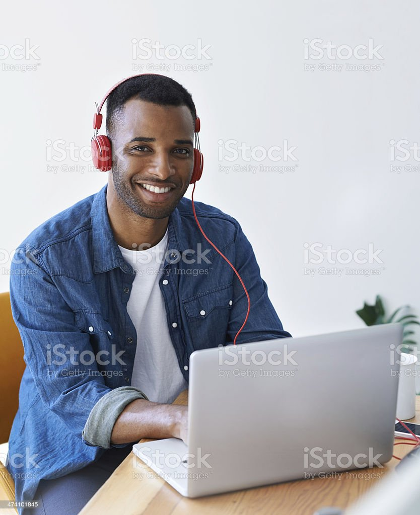 Creative work is enhanced by some great tunes royalty-free stock photo