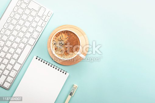 istock Creative work space background with keyboard, coffee and stationery 1137004307