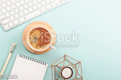 istock Creative work space background with keyboard, coffee and stationery 1137004330