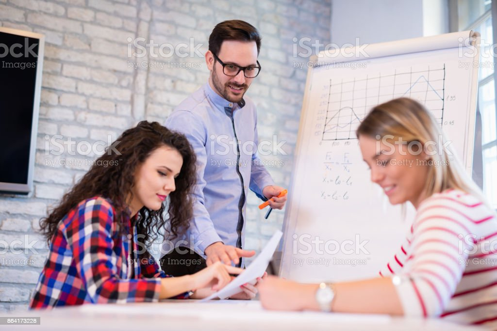Creative young business people and architects working in office royalty-free stock photo