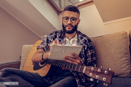 istock Creative young man noting down his ideas 1098012070