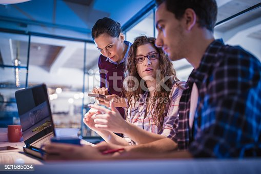 1063657732 istock photo Creative, young, office coworkers talking during meeting together in design studio 921585034
