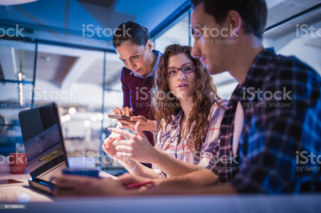 Creative, young, office coworkers talking during meeting together in design studio stock photo