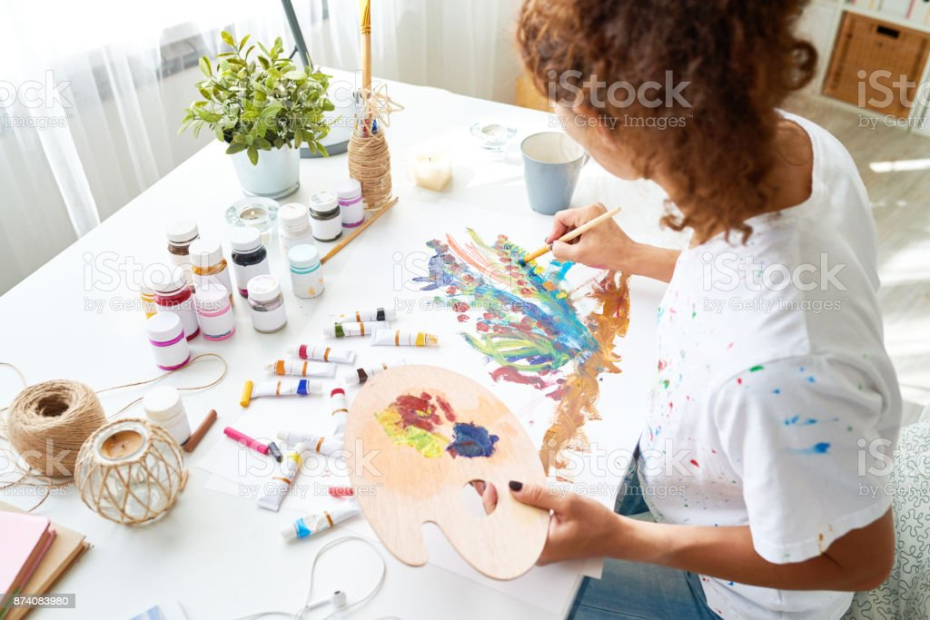 Creative Young Woman Painting Pictures stock photo