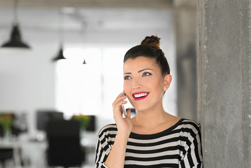 Creative Young Woman Talking On Phone In The Office Stock Photo - Download Image Now