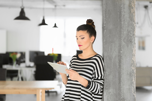 Creative Young Woman Using A Digital Tablet In The Office Stock Photo - Download Image Now