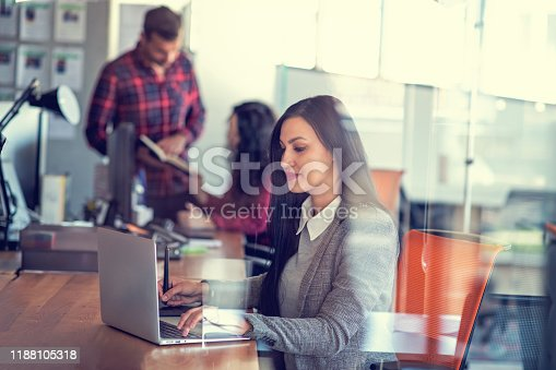 Creative young woman working in office with graphic tablet.