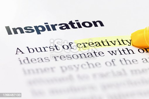 Detail of a textbook emphasizes the words Inspiration and Creativity.