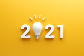 istock 2021 creativity inspiration concepts, Light bulb idea with 2021 new year, planning ideas. 1257182595