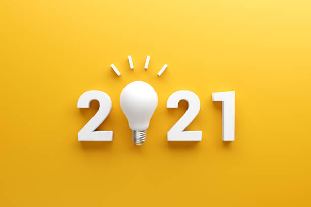 2021 creativity inspiration concepts, Light bulb idea with 2021 new year, planning ideas. 2021 creativity inspiration concepts, Light bulb idea with 2021 new year on yellow background, planning ideas. 2021 stock pictures, royalty-free photos & images