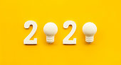 istock 2020 creativity inspiration concepts with text nuber and lightbulb on color background 1159201352