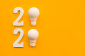 istock 2020 creativity inspiration concepts with text nuber and lightbulb on color background 1159201362