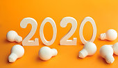 istock 2020 creativity inspiration concepts with text nuber and lightbulb on color background.Business resolution,action plan ideas. 1162056311