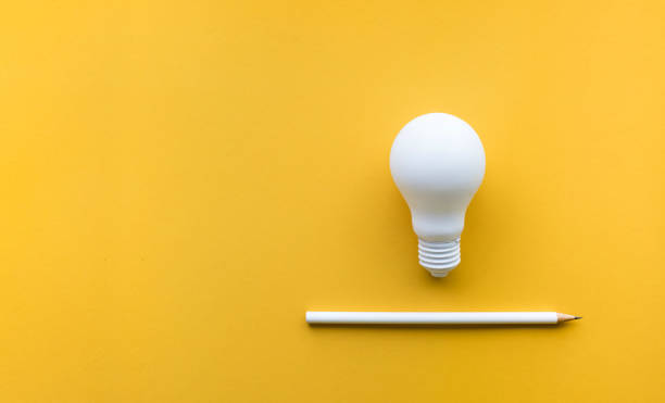 Creativity inspiration,ideas concept with lightbulb stock photo