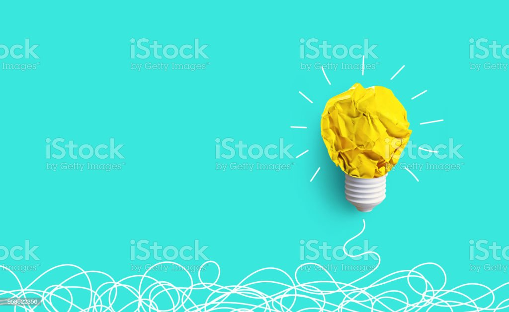 Creativity inspiration,ideas concepts with lightbulb from paper crumpled ball stock photo