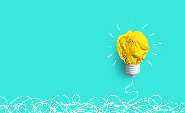 Creativity inspiration,ideas concepts with lightbulb from paper crumpled ball Creativity inspiration,ideas concepts with lightbulb from paper crumpled ball on pastel color background.Flat lay design. brainstorming stock pictures, royalty-free photos & images