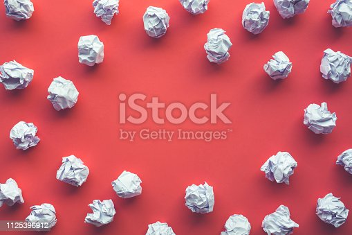 istock Creativity inspiration,ideas concepts with paper crumpled ball on red color 1125396912