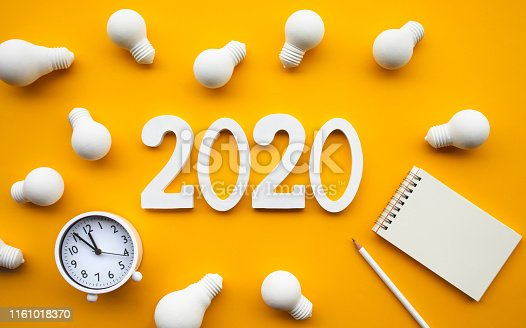 istock Creativity of 2020 concepts with group of lightbulb and text number on pastel color background.Business solution.Performance of human. 1161018370