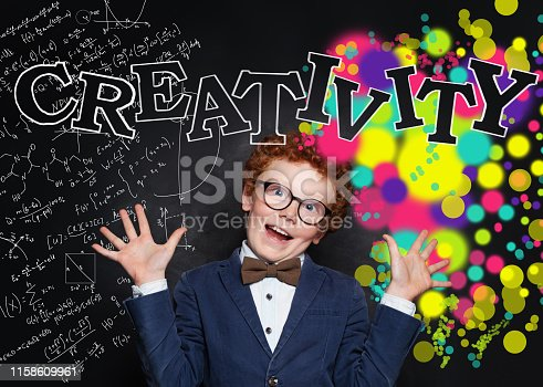 143176157 istock photo Creativity school concept. Funny smart boy on blackboard background with science formulas and art pattern 1158609961