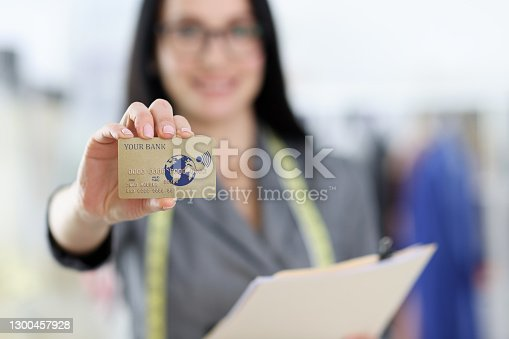 Credit bank plastic card in woman's hand. Bank card payments concept
