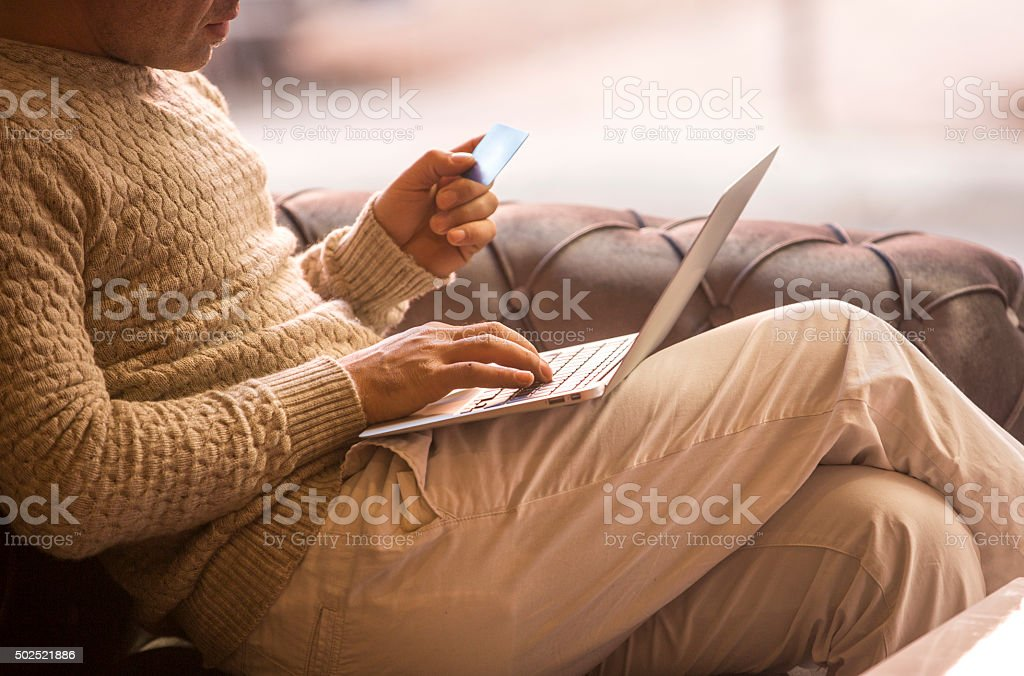 credit card and typing stock photo