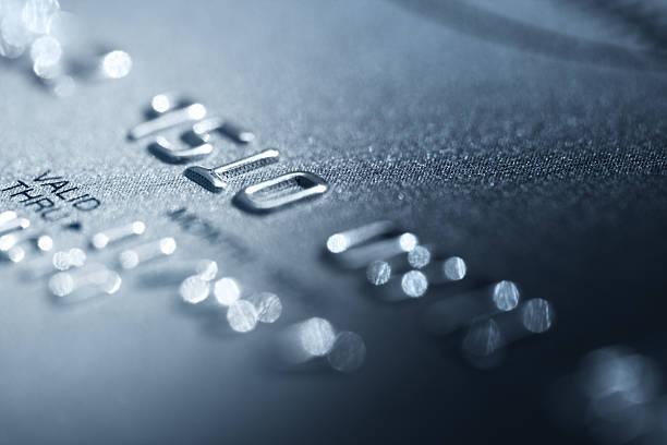 Credit card detail photo focused on raised printed numbers stock photo