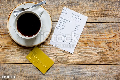 istock credit card for paying, coffee and check on cafe wooden desk background top view mock up 684481116