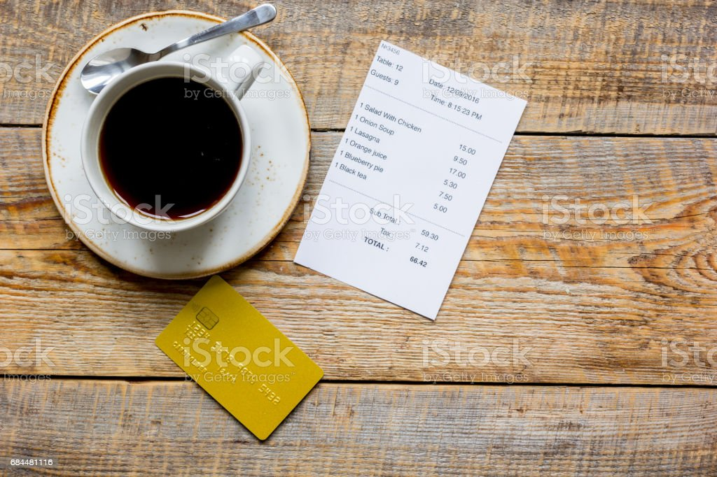 credit card for paying, coffee and check on cafe wooden desk background top view mock up stock photo