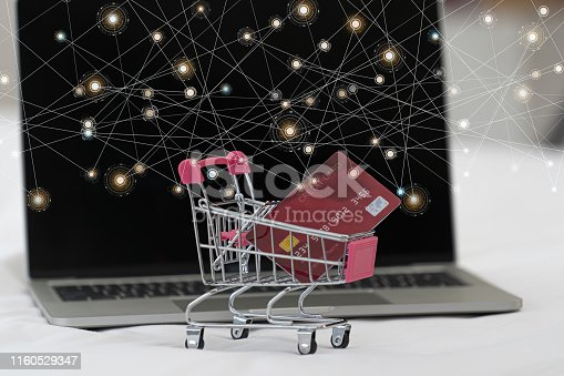 istock Credit card in shopping cart.Blockchain finance web money business concept. 1160529347