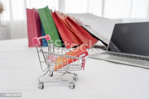 istock Credit card in shopping cart.Blockchain finance web money business concept. 1166220076