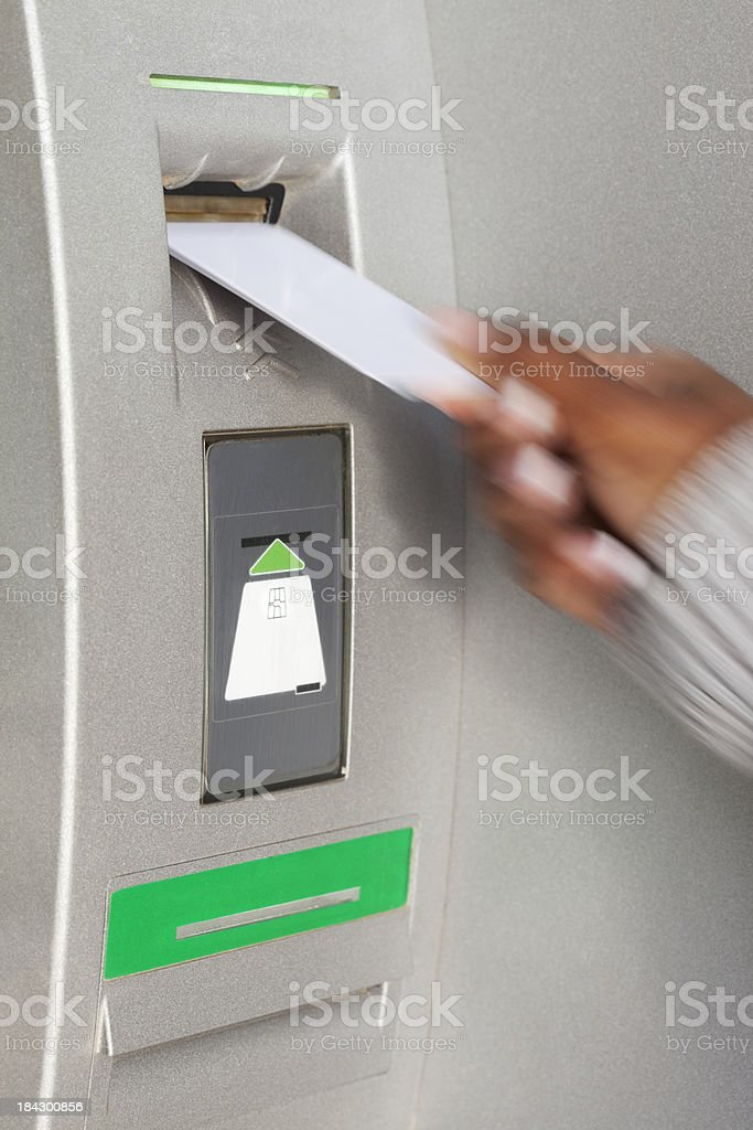 Credit card insertion into ATM. stock photo