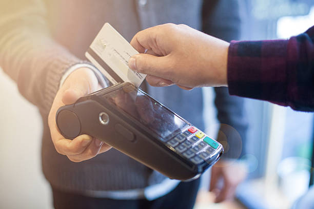 Credit card machine payment Credit card machine payment smart card stock pictures, royalty-free photos & images