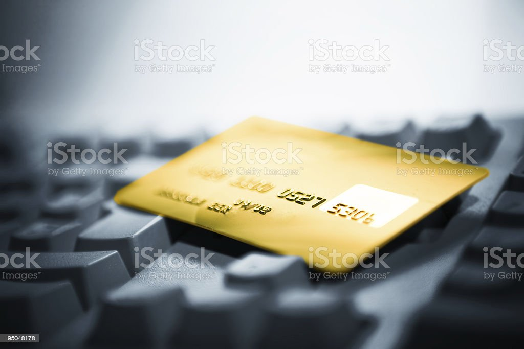 A credit card on a laptop keyboard stock photo