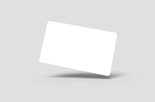 Credit Card or Business Card Blank white credit card floating on angle or blank business card floating on angle charging stock pictures, royalty-free photos & images