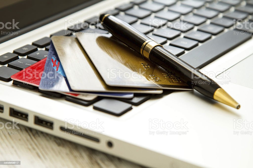 Credit card over a keyboard stock photo
