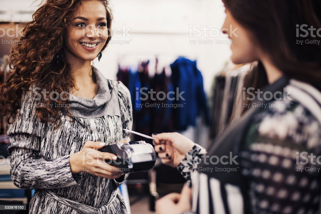 Credit card payment in a fashion store stock photo