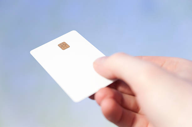 credit card hand holding blank white credit card on blured blue background smart card stock pictures, royalty-free photos & images