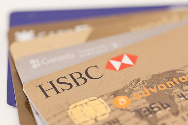Credit Card Istanbul, Turkey - June 12, 2011:close up of HSBC credit card and on the background other banks credit cards. hsbc stock pictures, royalty-free photos & images