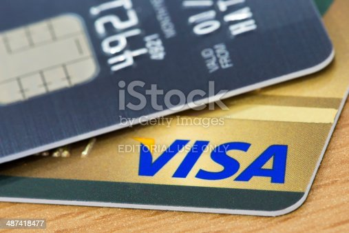 BANGKOK, THAILAND - February 27, 2014: Closeup of VISA credit card with smart ship on wood texture background. VISA is one of the three biggest brands.