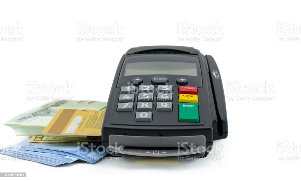 Credit card reader machine and banknote  on white background. stock photo