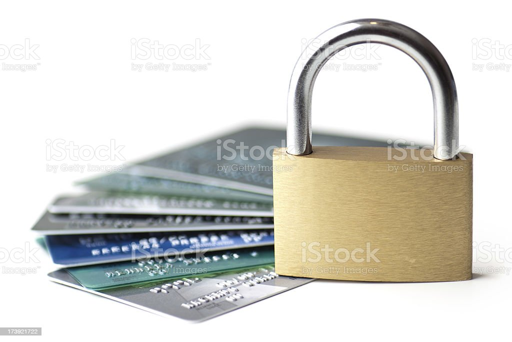 Credit card safety Safe banking concept, several credit cards with a padlock on top. Numbers and letters have been retouched until they bear no resemblance to the original. You may also like:  Banking Stock Photo