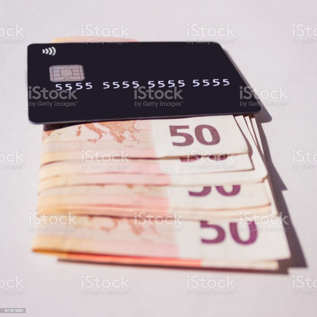 Credit  card with cash. Concept - Finance, business, cashless payment. Selective focus. stock photo