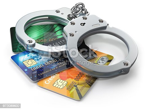 istock Credit card with handcuffs isolated on white background.  Banking financial crime  and accounting fraud concept. 972089632