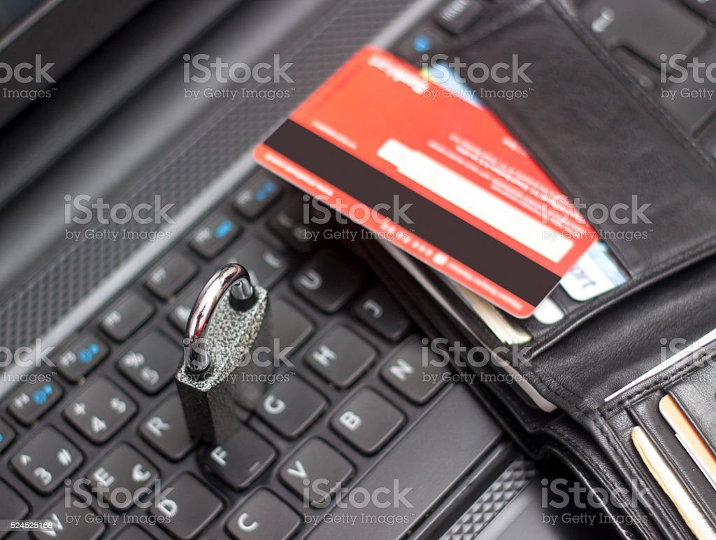 Credit card with wallet on computer keyboard stock photo