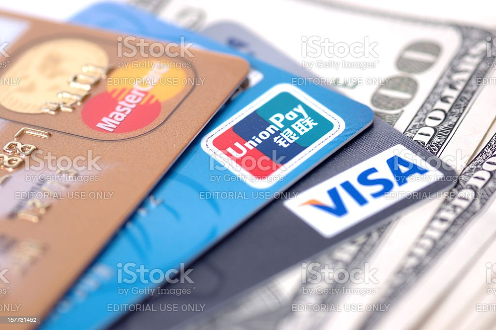 credit cards and US dollars stock photo